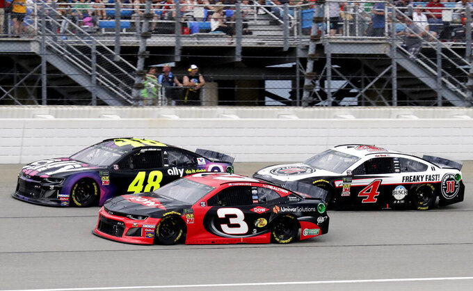 Jimmie Johnson (48), Austin Dillon (3) and Kevin Harvick (4) compete during a NASCAR Cup Series auto race at Chicagoland Speedway in Joliet, Ill., Sunday, June 30, 2019. (AP Photo/Nam Y. Huh)