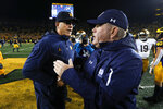 Michigan head coach Jim Harbaugh, left, and Notre Dame head coach Brian Kelly shake hands after an NCAA college football game in Ann Arbor, Mich., Saturday, Oct. 26, 2019. Michigan won 45-14. (AP Photo/Paul Sancya)