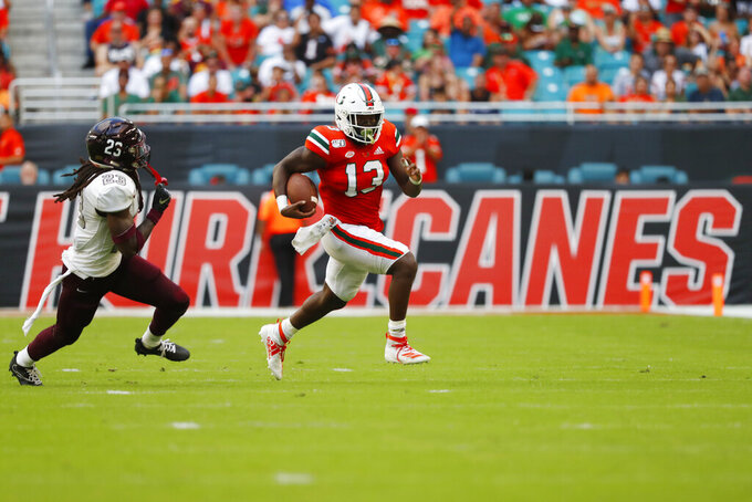 Miami running back DeeJay Dallas (13) is pursued by Bethune-Cookman safety Vernon Walker III (23) on a touchdown run during the first half of an NCAA college football game Saturday, Sept. 14, 2019, in Miami Gardens, Fla. (AP Photo/Wilfredo Lee)