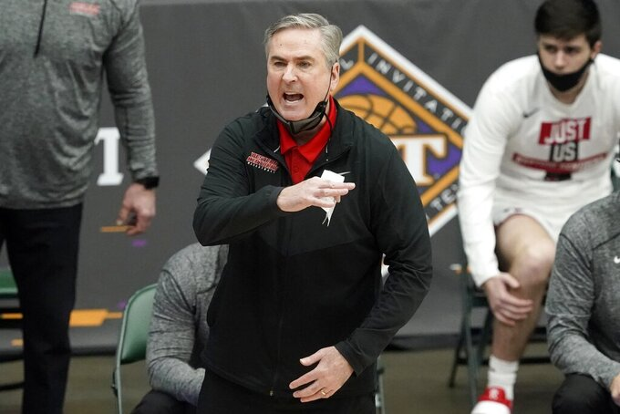Western Kentucky coach Rick Stansbury gestures during the first half of the team's NCAA college basketball game against Louisiana Tech in the quarterfinals of the NIT, Thursday, March 25, 2021, in Frisco, Texas. (AP Photo/Tony Gutierrez)