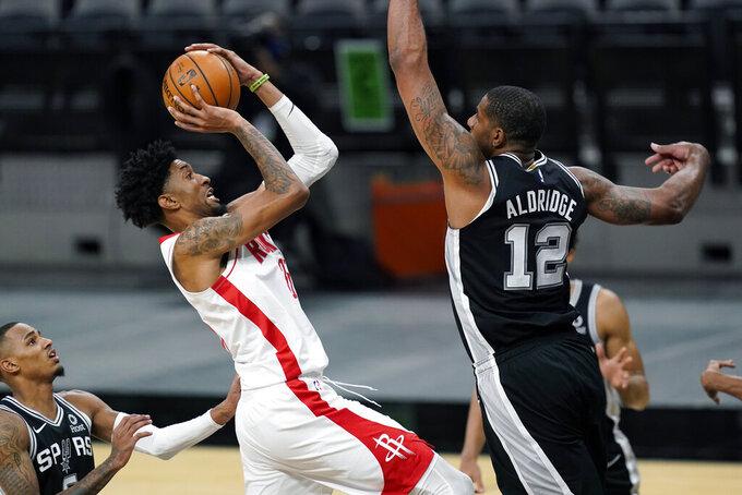 Houston Rockets center Christian Wood (35) shoots against San Antonio Spurs center LaMarcus Aldridge (12) during the second half of an NBA basketball game in San Antonio, Thursday, Jan. 14, 2021. (AP Photo/Eric Gay)