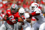 Ohio State defensive end Chase Young, left, fights off blocks from Florida Atlantic running back Larry McCammon, center, and lineman Brandon Walton during the first half of an NCAA college football game Saturday, Aug. 31, 2019, in Columbus, Ohio. (AP Photo/Jay LaPrete)