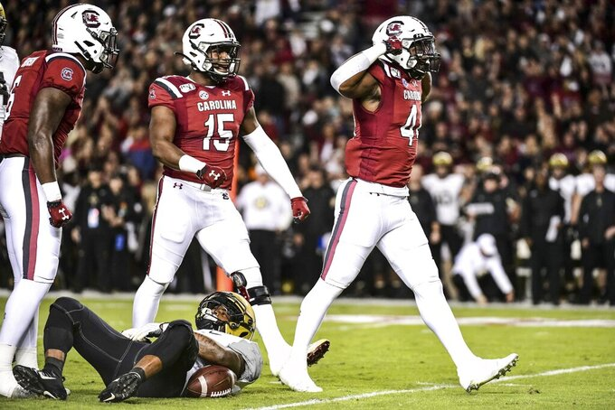 South Carolina linebacker Sherrod Greene (44) celebrates a tackle with Aaron Sterling (15) during the first half of an NCAA college football game  against Vanderbilt, Saturday, Nov. 2, 2019, in Columbia, S.C. (AP Photo/Sean Rayford)