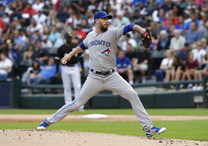 FILE - Toronto Blue Jays starting pitcher John Axford throws against the Chicago White Sox during the first inning of a baseball game in Chicago, in this Saturday, July 28, 2018, file photo. Reliever John Axford's comeback attempt is taking a detour from Toronto to Milwaukee, where the right-hander started his major league career. Brewers president of baseball operations David Stearns announced Monday, Aug., 2, 2021, the team had acquired the 38-year-old Axford from the Blue Jays for cash considerations. (AP Photo/Nam Y. Huh, File)