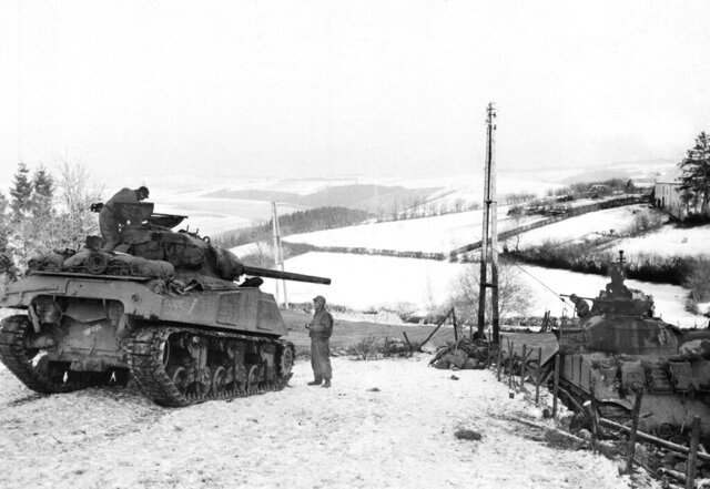 "In this Jan. 6, 1945 file photo, American tanks wait on the snowy slopes in Bastogne,Belgium. It was 75 years ago that Hitler launched his last desperate attack to turn the tide for Germany in World War II. At first, German forces drove so deep through the front line in Belgium and Luxembourg that the month-long fighting came to be known as The Battle of the Bulge. When the Germans asked one American commander to surrender, the famous reply came: ""Nuts!"