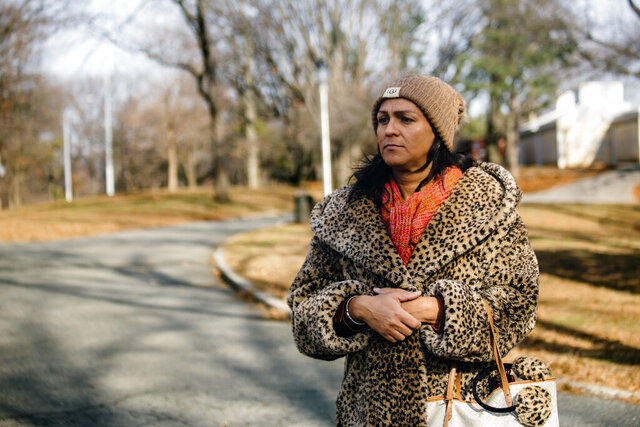 In this Jan. 14, 2019, photo provided by the New York Civil Liberties Union, Linda Dominguez, a transgender woman at the center of a civil rights lawsuit filed by the American Civil Liberties Union and the NYCLU against the New York Police Department, poses for a photo in New York. The NYPD will have to give its force more training on protecting the rights of transgender people as part of a deal announced Tuesday, Nov. 10, 2020, that settles the lawsuit accusing officers of mocking Dominguez by putting her in pink handcuffs. The city will also be required to pay Dominguez $30,000 over allegations that police officers wrongly accused her of misrepresenting her identity. (Sy Klipsch-Abudu/NYCLU via AP)