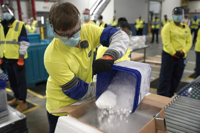 FILE - In this Dec. 13, 2020, file photo, dry ice is poured into a box containing the Pfizer COVID-19 vaccine as it is prepared to be shipped at the Pfizer Global Supply Kalamazoo manufacturing plant in Portage, Mich. The Biden administration plans to provide 500 million shots purchased from Pfizer to 92 lower income countries and the African Union over the next year through the U.N.-backed COVAX program. (AP Photo/Morry Gash, Pool, File)