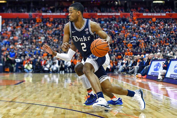 Duke guard Cassius Stanley drives to the basket against Syracuse during the first half of an NCAA college basketball game in Syracuse, N.Y., Saturday, Feb. 1, 2020. (AP Photo/Adrian Kraus)