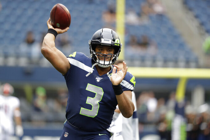 Seattle Seahawks quarterback Russell Wilson warms up for the team's NFL football preseason game against the Denver Broncos, Thursday, Aug. 8, 2019, in Seattle. (AP Photo/Elaine Thompson)