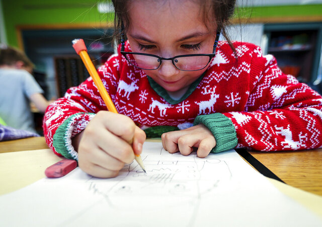 ADVANCE FOR PUBLICATION ON SATURDAY, DEC. 21, AND THEREAFTER - Kona Robertson focuses on her drawing during her Young Rembrandts course at South Canyon Elementary in Rapid City, S.D., on Wednesday, Dec. 11, 2019. (Adam Fondren/Rapid City Journal via AP)