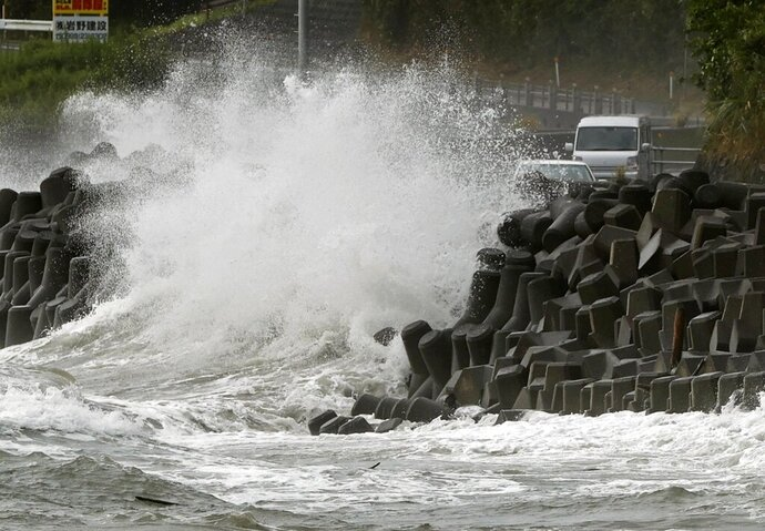 High waves pound the coast of the Kagoshima city, southwestern Japan Sunday, Sept. 6, 2020. The second powerful typhoon to slam Japan in a week unleashed fierce winds and rain on southern islands on Sunday, blowing off rooftops and leaving homes without power as it edged northward into an area vulnerable to flooding and mudslides. (Takuto Kaneko/Kyodo News via AP)