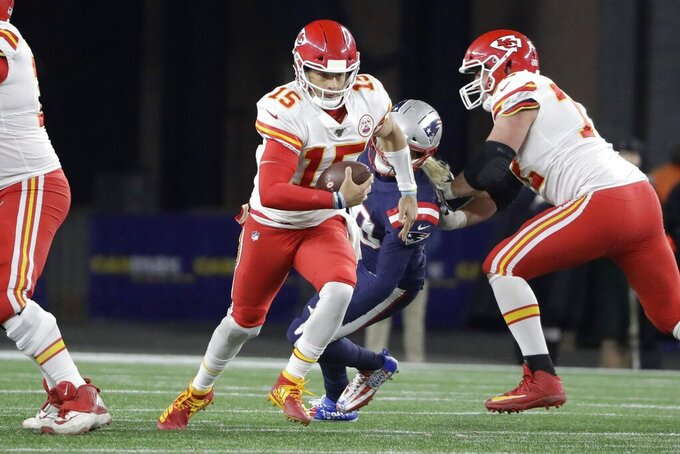 Kansas City Chiefs quarterback Patrick Mahomes runs against the New England Patriots in the second half of an NFL football game, Sunday, Dec. 8, 2019, in Foxborough, Mass. (AP Photo/Steven Senne)