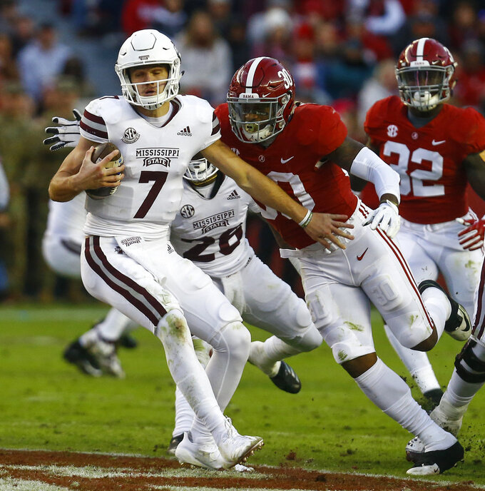 Mississippi State quarterback Nick Fitzgerald (7) tries to escape pressure from Alabama linebacker Mack Wilson (30) during the second half of an NCAA college football game, Saturday, Nov. 10, 2018, in Tuscaloosa, Ala. (AP Photo/Butch Dill)