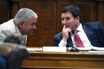 House Speaker Philip Gunn, R-Clinton, left, and House Ways and Means Committee chairman Trey Lamar, R-Senatobia, confer, during a joint legislative tax study committee hearing at the Capitol in Jackson, Miss., Wednesday, Aug. 25, 2021. Lawmakers are holding two days of hearings on eliminating or cutting Mississippi's individual income tax. (AP Photo/Rogelio V. Solis)