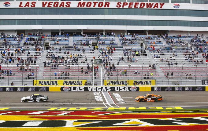 AJ Allmendinger (16) maintains a lead over Daniel Hemric (18) in the final laps of a NASCAR Xfinity Series auto race at Las Vegas Motor Speedway, Saturday, March 6, 2021. (Chase Stevens/Las Vegas Review-Journal via AP)