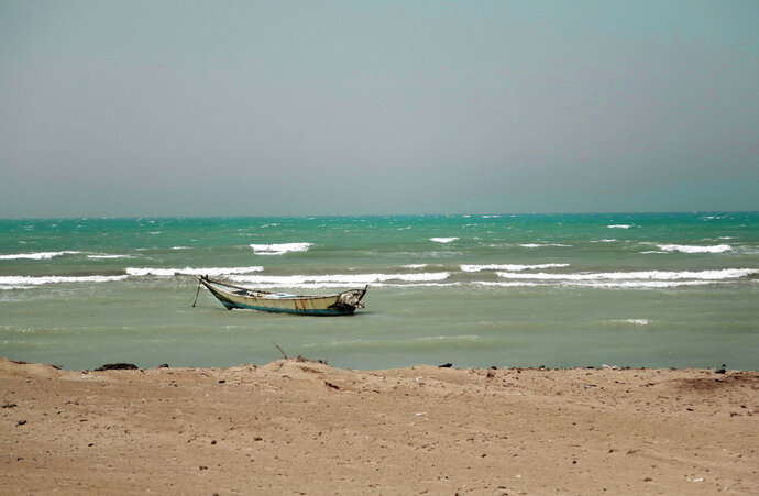 FILE - In this Feb. 12, 2018 file photo, a small boat is anchored near the Red Sea port of Hodeida, Yemen. The Saudi-led coalition backing Yemen's exiled government began an assault Wednesday, June 13, 2018 on the port city of Hodeida, the main entry point for food in a country already teetering on the brink of famine.(AP Photo/Nariman El-Mofty)