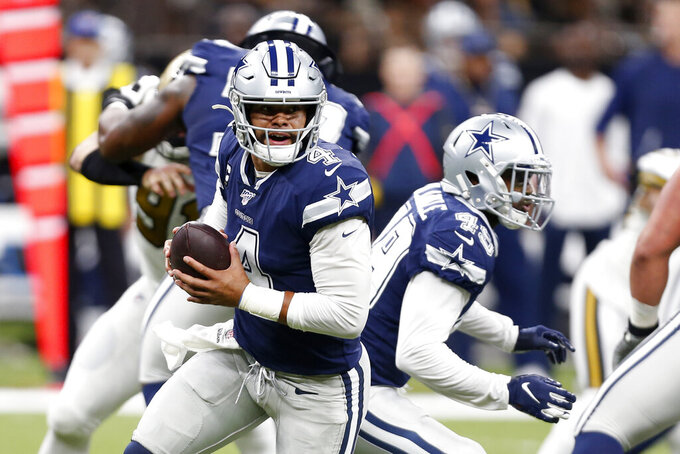 Dallas Cowboys quarterback Dak Prescott (4) scrambles in the first half of an NFL football game against the New Orleans Saints in New Orleans, Sunday, Sept. 29, 2019. (AP Photo/Gerald Herbert)