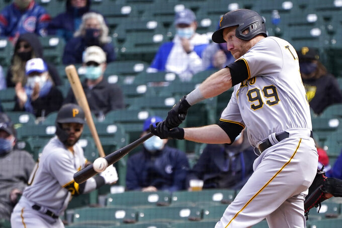 Pittsburgh Pirates' Todd Frazier (99) grounds out to Chicago Cubs' Javier Baez during the ninth inning of a baseball game Friday, May 7, 2021, in Chicago. Colin Moran scored on the play. (AP Photo/Charles Rex Arbogast)