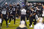 Philadelphia Eagles players celebrate after winning an NFL football game against the New Orleans Saints, Sunday, Dec. 13, 2020, in Philadelphia. (AP Photo/Chris Szagola)
