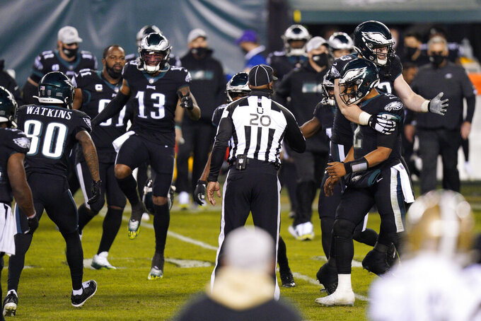 Philadelphia Eagles players celebrate after winning an NFL football game against the New Orleans Saints, Sunday, Dec. 13, 2020, in Philadelphia. (AP Photo/Chris Szagola)