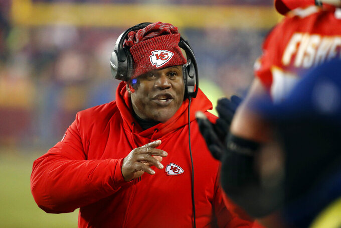 FILE - In this Jan. 20, 2019, file photo, Kansas City Chiefs offensive coordinator Eric Bieniemy gestures during the second half of the AFC Championship NFL football game, in Kansas City, Mo. The Browns are interviewing Chiefs offensive coordinator Eric Bieniemy Friday, Jan. 3, 2010, in Kansas City for their head coaching vacancy, the club announced.(AP Photo/Charlie Riedel, File)