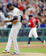 New York Yankees starting pitcher Domingo German, left, waits for Cleveland Indians' Tyler Naquin to run the bases on a solo home run during the fifth inning in a baseball game Friday, June 7, 2019, in Cleveland. (AP Photo/Tony Dejak)
