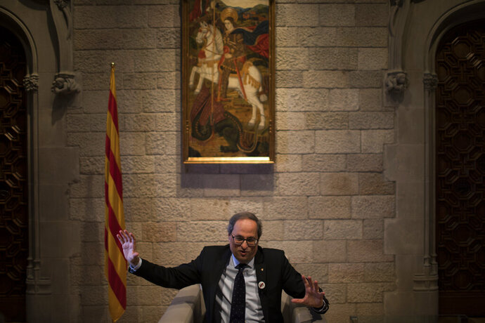 In this Thursday, Jan. 10, 2019 photo, Catalan regional president Quim Torra speaks during an interview with the Associated Press, at the Palace of Generalitat or Catalan government headquarters, in Barcelona, Spain. Catalonia separatist leader says that the Spanish government's bid to pass a national budget is doomed unless the wealthy northeastern region is allowed to hold a referendum on secession from the rest of the country. (AP Photo/Emilio Morenatti)