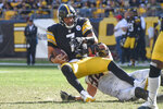 Pittsburgh Steelers quarterback Ben Roethlisberger (7) is sacked by Cincinnati Bengals defensive end Sam Hubbard (94) during the second half an NFL football game, Sunday, Sept. 26, 2021, in Pittsburgh. The Bengals won 24-10. (AP Photo/Don Wright)