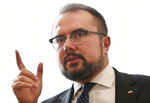 Polish Deputy Foreign Minister Paweł Jabłoński speaks to The Associated in Warsaw, Poland, Tuesday, Sept. 8, 2020. Jabłoński said that Poland's government welcomes signals that Germany might stop a controversial gas pipeline project, Nord Stream 2, over the poisoning of Russian dissident Alexei Navalny.(AP Photo/Czarek Sokolowski)