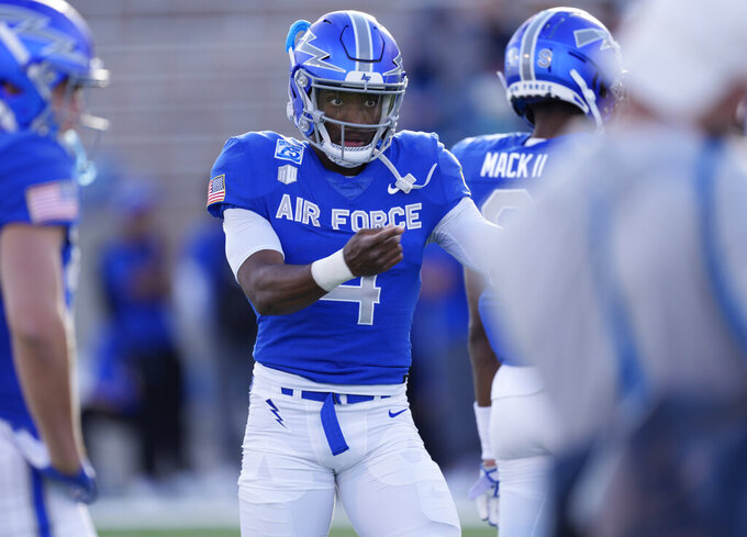 Air Force quarterback Haaziq Daniels warms up before an NCAA college football game against San Diego State, Saturday, Oct. 23, 2021, at Air Force Academy, Colo. (AP Photo/David Zalubowski)