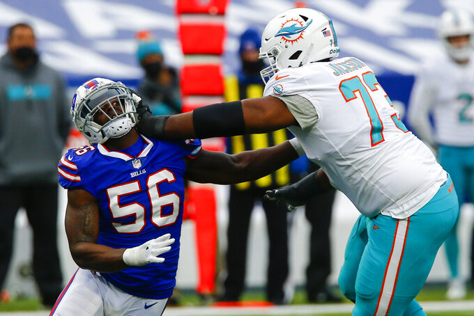 Buffalo Bills defensive end Mike Love (56) is blocked by Miami Dolphins offensive tackle Austin Jackson (73) in the first half of an NFL football game, Sunday, Jan. 3, 2021, in Orchard Park, N.Y. (AP Photo/John Munson)