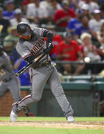 Arizona Diamondbacks' Eduardo Escobar swings for a home run, his second of the night, during the sixth inning of the team's baseball game against the Texas Rangers on Wednesday, July 17, 2019, in Arlington, Texas. (AP Photo/Richard W. Rodriguez)