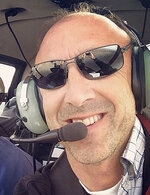 FILE - This undated file photo provided by Group 3 Aviation shows helicopter pilot Ara Zobayan, who was at the controls of the helicopter that crashed in Southern California Sunday, Jan. 26, 2020, killing all nine aboard including former Lakers star Kobe Bryant. Zobayan violated federal flight rules in 2015 when he flew into busy airspace near Los Angeles International Airport despite being ordered not to by air traffic control, according to records from the Federal Aviation Administration obtained by the Los Angeles Times. (Group 3 Aviation via AP, File)