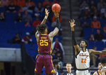 Minnesota center Daniel Oturu shoots over Oklahoma State forward Kalib Boone during an NCAA college basketball game Saturday, Dec. 21, 2019, in Tulsa, Okla. (Brett Rojo/Tulsa World via AP)