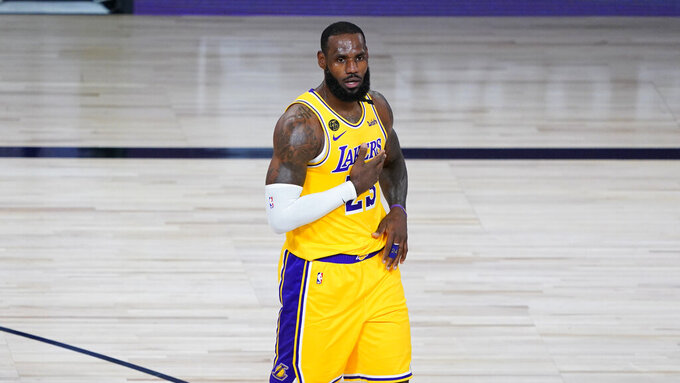 Los Angeles Lakers' LeBron James (23) reacts after a basket during the first half of an NBA basketball game against the Denver Nuggets, Monday, Aug. 10, 2020, in Lake Buena Vista, Fla. (AP Photo/Ashley Landis, Pool)