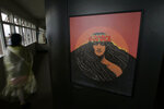 FILE - In this Sept. 10, 2009 file photo, a portrait of volcano deity Pele by famed Hawaiian artist Herb Kawainui Kane is on display at the Jagger Museum and Hawaiian Volcano Observatory in Hawai'i Volcanoes National Park on the island of Hawaii. When residents of rural Hawaii neighborhoods where lava from Kilauea volcano has burned down or threatened to consume their homes, a name often comes up: Pele. Pele, known as the goddess of volcanoes and fire, is an important figure in Hawaiian culture. (AP Photo/Chris Stewart, File)