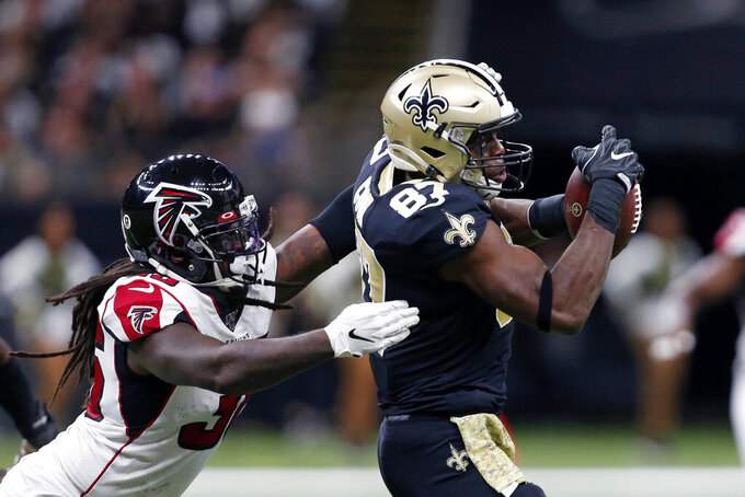 New Orleans Saints tight end Jared Cook (87) pulls in a pass in front of Atlanta Falcons defensive back Kemal Ishmael (36) in the first half of an NFL football game in New Orleans, Sunday, Nov. 10, 2019. (AP Photo/Butch Dill)