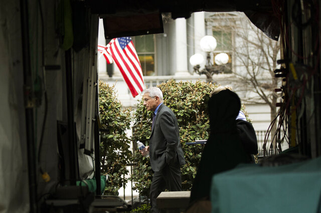 Director of the National Institute of Allergy and Infectious Diseases at the National Institutes of Health Anthony Fauci walks on the North Lawn outside the West Wing at the White House, after TV interviews Thursday, March 12, 2020, in Washington. (AP Photo/Manuel Balce Ceneta)