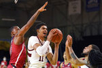 Stanford forward Jaiden Delaire (11) shoots between Arizona guard James Akinjo, left, and Terrell Brown Jr. during the second half of an NCAA college basketball game in Santa Cruz, Calif., Saturday, Dec. 19, 2020. (AP Photo/Jeff Chiu)