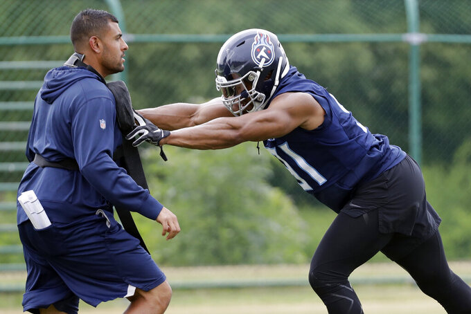 Tennessee Titans outside linebacker Cameron Wake, right, runs a drill during an organized team activity at the Titans' NFL football training facility Tuesday, June 4, 2019, in Nashville, Tenn. Fans have been wanting to know how Tennessee will get more sacks after the retirement of Brian Orakpo and the free agent signing of 37-year-old Cameron Wake. (AP Photo/Mark Humphrey)