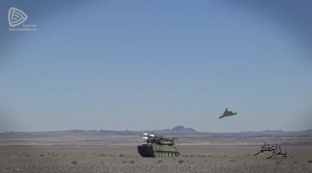 In this photo released Friday, Jan. 15, 2021, by the Imamedia a suicide drone approaches the target during a drill. Iran's paramilitary Revolutionary Guard conducted a drill Friday that saw