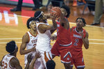 Texas forward Gerald Liddell (0) battles for the ball against Texas Rio Grande Valley's Chris Freeman (0) during the first half of an NCAA college basketball game, Wednesday, Nov. 25, 2020 in Austin, Texas. (Ricardo B. Brazziell/Austin American-Statesman via AP)