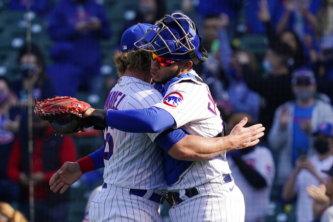 Chicago Cubs relief pitcher Craig Kimbrel, left, celebrates with catcher Willson Contreras after the Cubs defeated the Pittsburgh Pirates 4-3 in a baseball game in Chicago, Sunday, April 4, 2021. (AP Photo/Nam Y. Huh)