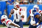 New England Patriots quarterback Cam Newton (1) looks to pass during the first half of an NFL preseason football game against the New York Giants Sunday, Aug. 29, 2021, in East Rutherford, N.J. (AP Photo/Noah K. Murray)