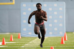 North Carolina running back Michael Carter participates in the school's Pro Day football workout for NFL scouts in Chapel Hill, N.C., Monday, March 29, 2021. (AP Photo/Gerry Broome)