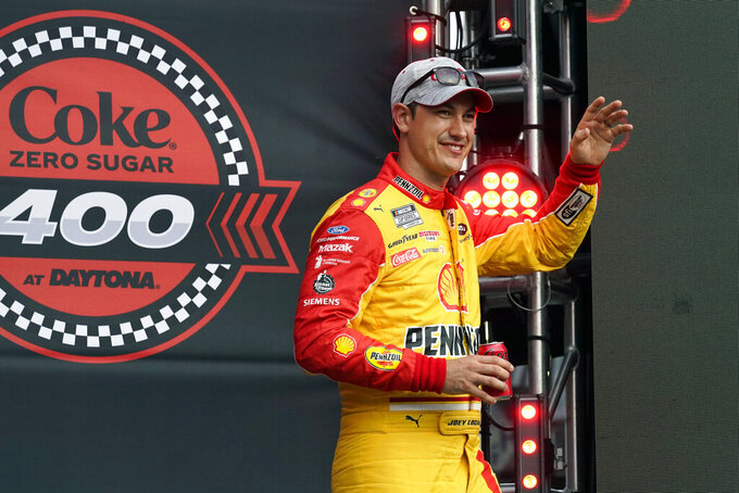 Joey Logano waves to fans during driver introductions before the NASCAR Cup Series auto race at Daytona International Speedway, Saturday, Aug. 28, 2021, in Daytona Beach, Fla. (AP Photo/John Raoux)