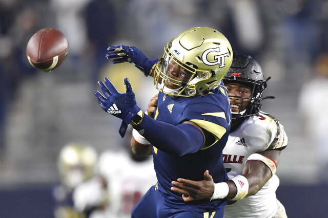 Georgia Tech wide receiver Jalen Camp (1) is not able to catch a pass under pressure from Louisville defensive back Russ Yeast during the first half of an NCAA college football game Friday, Oct. 9, 2020, in Atlanta. (Hyosub Shin/Atlanta Journal-Constitution via AP)