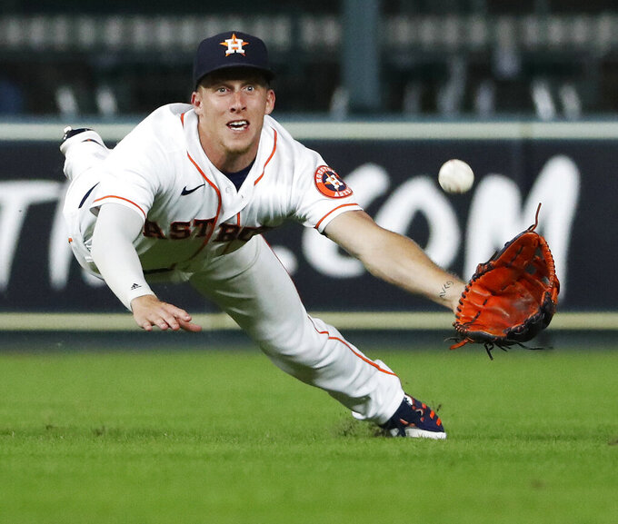 Houston Astros center fielder Myles Straw dives for but misses a ball hit by Texas Rangers' Isiah Kiner-Falefa, who broke up a no-hitter in the eighth inning of a baseball game Saturday, July 24, 2021, in Houston. (Kevin M. Cox/The Galveston County Daily News via AP)