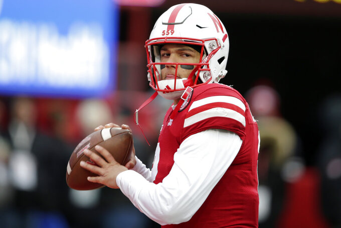 Nebraska quarterback Adrian Martinez (2) warms up before an NCAA college football game against Michigan State in Lincoln, Neb., Saturday, Nov. 17, 2018. (AP Photo/Nati Harnik)