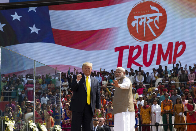 U.S. President Donald Trump and Indian Prime Minister Narendra Modi wave after a